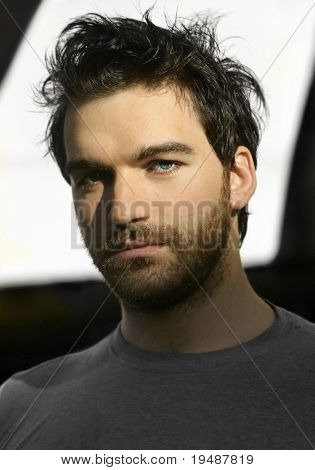 Shadowy portrait of a young bearded man