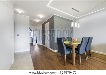 Dinning corner in luxury apartment with wooden table and chairs