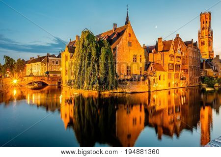 Bruges (Brugge) cityscape with water canal at night, Flanders, Belgium