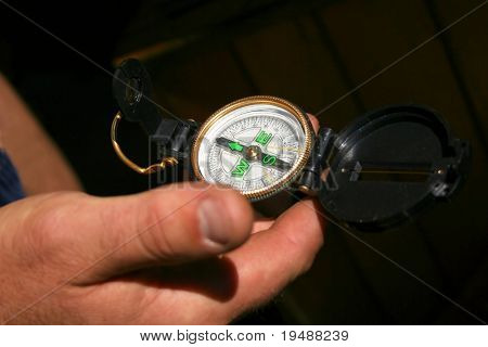 Definition of a way on a compass. A compass in a hand of the captain.
