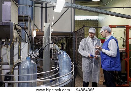 ST. PETERSBURG, RUSSIA - JUNE 29, 2017: Deputy director of St. Petersburg Quality Control Center Vladimir Barinov (left) talk with manager of the drinking water factory of Lider-Aqua  LTD