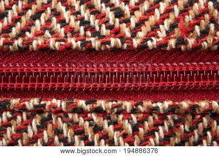 Closeup Of A Zipper In Midst Of Woolen Pattern Texture Material