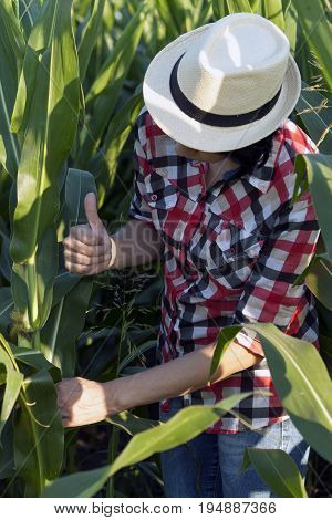 With Her Hand, She Shows That He Is Very Pleased With The Yield And Quality Of Corn