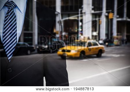 Mid section of well dressed businessman  against picture of a city