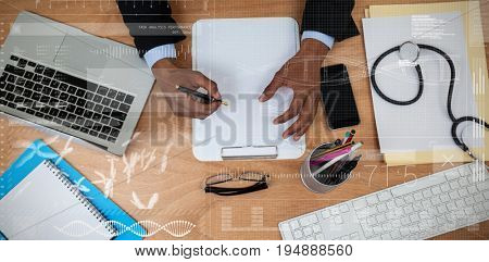 Data science against cropped hands of male doctor writing prescription