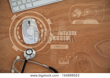Human heart illustration over black background against overhead view of computer mouse and keyboard with stethoscope