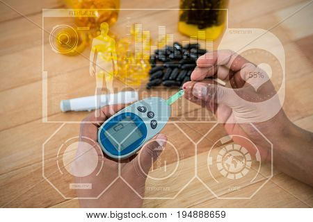Human heart fitness illustration against black background against cropped hands testing blood sugar with glucometer