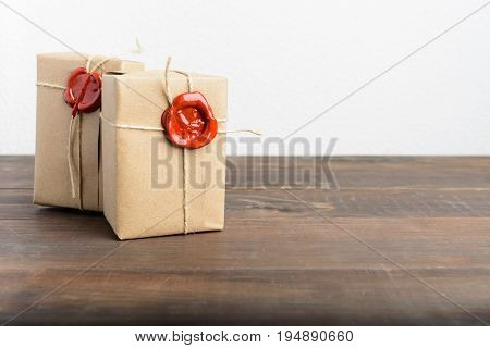 Two Parcels Wrapped In Craft Paper And Rope And Red Sealing Wax