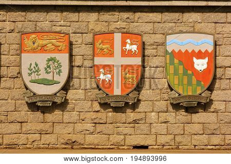 Victoria BC,Canada,April 11th 2014.Coats of arms for the Canadian provinces of PEI,Newfoundland and the Northwest Territory hang on a wall in Victoria BC.