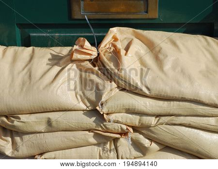 Stack of filled sandbags protect house from York Floods. The River Ouse occasionally breaches its banks and floods nearby properties in York.