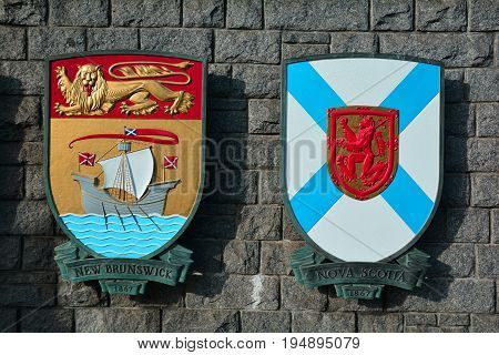 Victoria BC,Canada,January 23rd 2017.The coat of arms for the Canadian provinces of New Brunswick and Nova Scotia hang on a wall in Victoria BC.