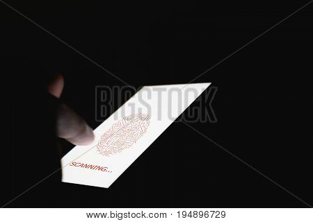 The hand is scanning biometric fingerprints for approval to access electronic devices. The concept of the danger of using electronic devices is important.