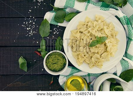 Farfalle Pasta With Pesto Genovese (basil Sauce) On Rustic Wooden Table. Italian Cuisine.  Flat Lay.