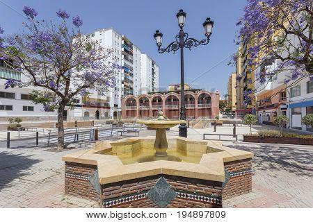 Market square with fountain in the city of San Pedro de Alcantara. Malaga Province Andalusia Spain