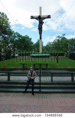 INDIAN RIVER, MICHIGAN / UNITED STATES - JUNE 18, 2017: The Cross in the Woods Roman Catholic National Shrine features the world's largest crucifix.