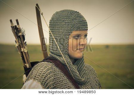 bows woman / medieval armor / historical story  / retro split toned