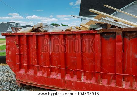 Dumpster with left over wood from construction