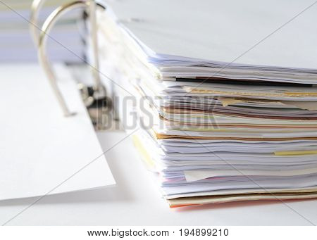 Business documents in document file at workplace,office supplies,high key tone.