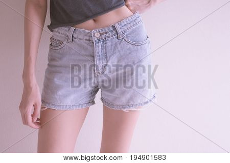 Photo of girl with blue jean shorts.