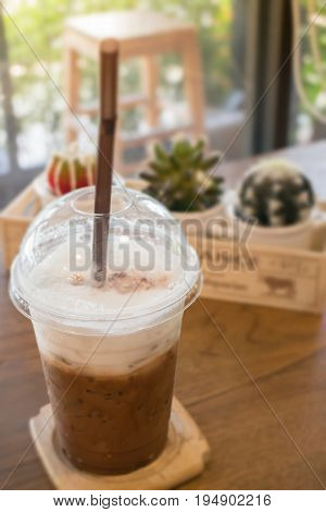 Iced coffee on wooden table stock photo