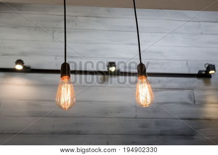 Vintage bulbs on wall background stock photo