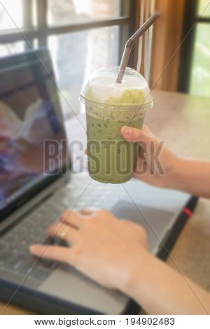 Woman using laptop in the coffee shop stock photo