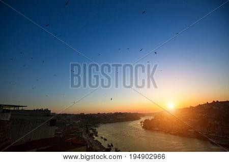 Douro river at evening time from Dom Luis I bridge, Porto, Portugal.