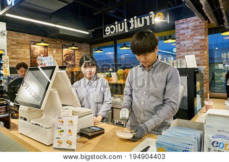 SEOUL, SOUTH KOREA - CIRCA MAY, 2017: workers at a convenience store in Seoul.