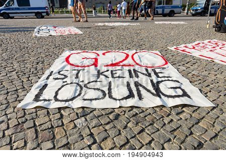 BERLIN - JULY 09 2017: Peaceful protest action against the G20 (Group of Twenty) policy at Pariser Platz in front of the Brandenburg Gate.
