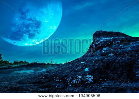 Landscape Of The Rock Against Blue Sky And Big Moon Above Wilderness Area In Forest.