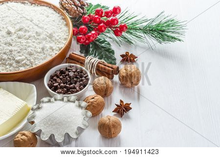 Ingredients for baking. Selection for Christmas cookies or muffins with chocolate drops selective focus.
