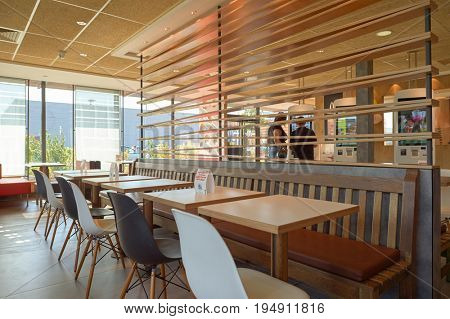 LA VILLE-AUX-DAMES, FRANCE - AUGUST 12, 2015: inside McDonald's restaurant. McDonald's is an American hamburger and fast food restaurant chain