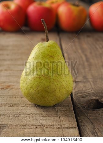 Red apples and gree pears on a rustic wooden table