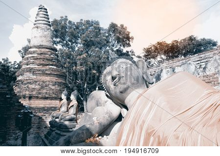 AYUTTHAYA,THAILAND- JULY 9 , 2017 : Ancient Reclining Buddha and Pagoda in Wat Phutthaisawan the monastery of Buddhist Kingship was built in 1353 AD in Ayutthaya Historical Park, Ayutthaya city,Middle of Thailand.