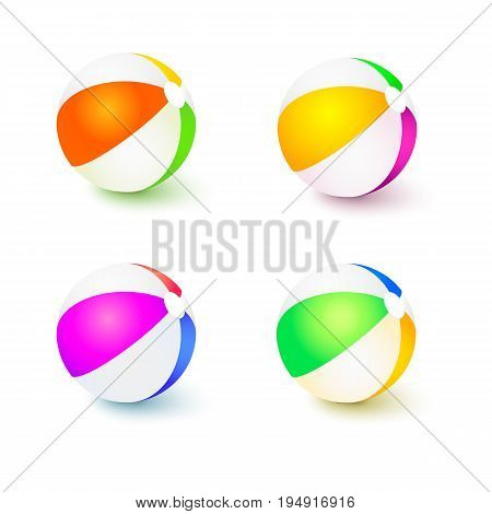 A set of colored inflatable beach balls. Realistic tri-colour bouncy ball with reflections and shadows isolated on white background. 3D illustration.