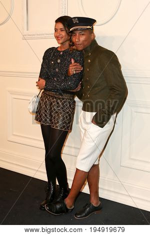 NEW YORK-MAR 31: Pharrell Williams (R) and wife Helen Lasichan attends the CHANEL Paris-Salzburg 2014/15 Metiers d'Art Show and Party at the Park Avenue Armory on March 31, 2015 in New York City.