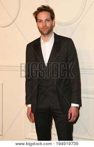 NEW YORK-MAR 31: Model Andy Gillet attends the CHANEL Paris-Salzburg 2014/15 Metiers d'Art Show and Party at the Park Avenue Armory on March 31, 2015 in New York City.