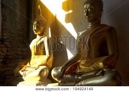 AYUTTHAYA,THAILAND- JULY 9 , 2017 : Golden sitting Buddha on cloister in Wat Phutthaisawan the monastery of Buddhist Kingship was built in 1353 AD in Ayutthaya Historical Park, Ayutthaya city , Middle of Thailand.