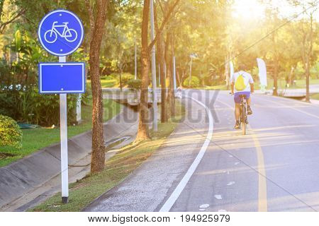 Bicycle lane with road and sunset in public park for designed to make cycling safer.