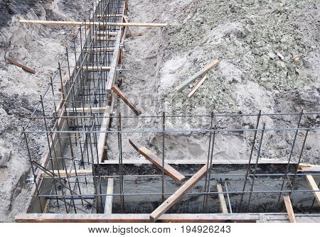 Building a Foundation construction for a new house. Types of Foundations. Pouring a concrete slab formwork along the foundation.