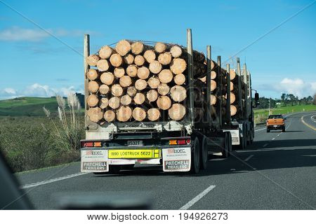 Northland New Zealand NZ - June 30 2017: Overtaking a logging truck on State Highway 1
