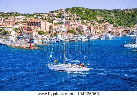 Sailboat in front of Port La Maddalena Island, Sardinia, Italy.