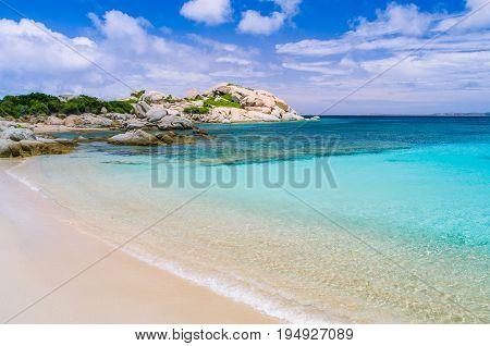 Azure beach with clear water near Porto Pollo on beautiful Sardinia island, Italy.