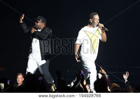NEW YORK-JUL 7: (L-R) Wanya Morris and Shawn Stockman of Boyz II Men perform during The Total Package Tour at NYCB Live at the Nassau Veterans Memorial Coliseum on July 7, 2017 in Uniondale, New York.