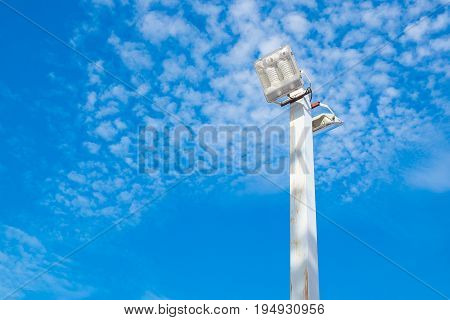 Lamp Post Electricity Industry With Blue Sky Background. Spotlight Tower.