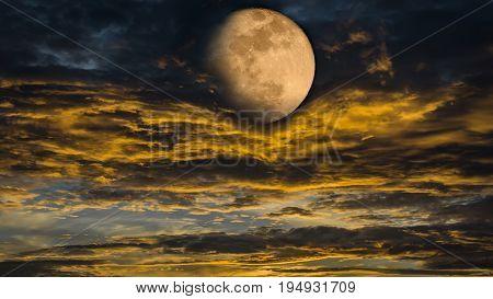 Beautiful Full moon in golden twilight at dusk