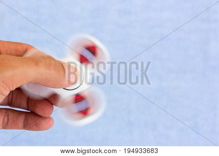 Virus toy spinner for children and adults. Antistress toy spinning in the hands on the bearings. Copy space for text