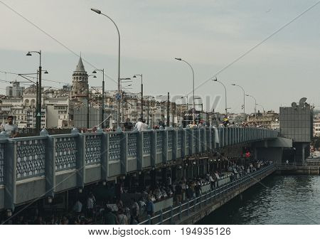 Istanbul, Turkey - June 22, 2017: View front of the Galata Bridge and Galata Tower over Halic, Golden Horn