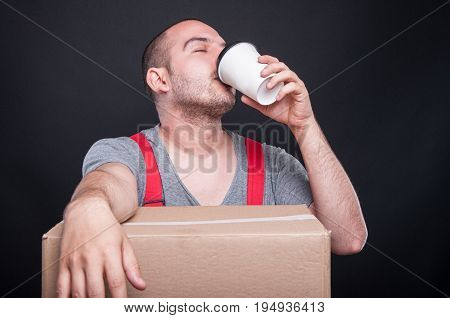 Mover Guy Drinking Coffee From Takeaway Cup