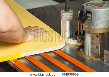 Carpenter works for Edge Banding Machine In workshop